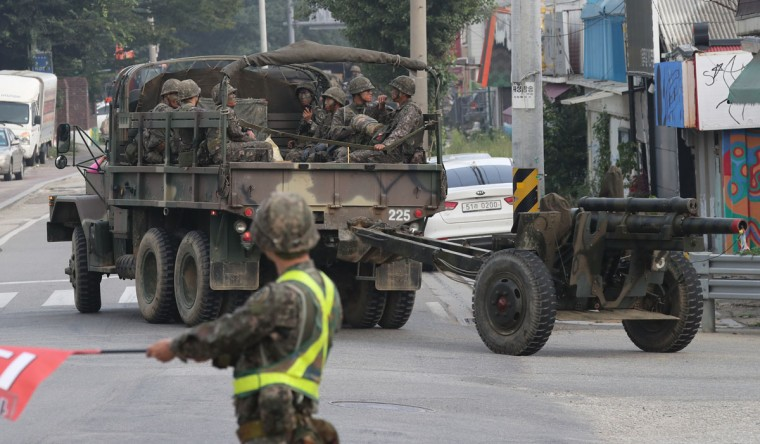"""South Korean army soldiers ride on a military truck towing the artillery in Paju, South Korea, Friday, Sept. 9, 2016. North Korea said it conducted a """"higher level"""" nuclear test explosion on Friday that will allow it to finally build """"at will"""" an array of stronger, smaller and lighter nuclear weapons. It was the North's fifth atomic test and the second in eight months. (Im Byung-shik/Yonhap via AP)"""