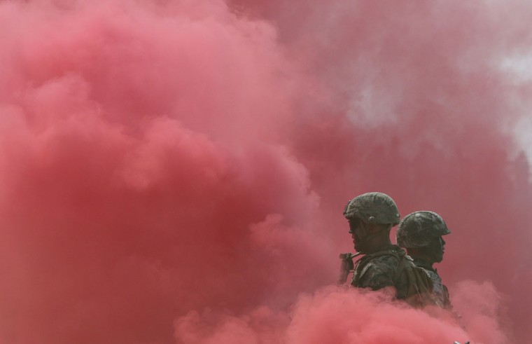 """South Korea and U.S. Marines stand in smoke during the 66th Incheon Landing Operations Commemoration ceremony in Incheon, South Korea, Friday, Sept. 9, 2016. Incheon is the coastal city where the United Nations Forces led by U.S. Gen""""ÄÇ Douglas MacArthur landed in September, 1950 just months after North Korea invaded the South. North Korea said Friday it conducted a """"higher level"""" nuclear warhead test explosion, which it trumpeted as finally allowing it to build """"at will"""" an array of stronger, smaller and lighter nuclear weapons. It is Pyongyang's fifth atomic test and the second in eight months. (AP Photo/Lee Jin-man)"""
