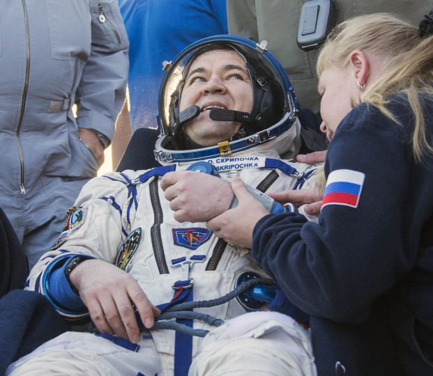 In this photo provided by NASA, Russian cosmonaut Oleg Skripochka of Roscosmos rests in a chair outside the Soyuz TMA-20M spacecraft a few moments after he and NASA astronaut Jeff Williams, and Russian cosmonaut Alexey Ovchinin of Roscosmos landed in a remote area near the town of Zhezkazgan, Kazakhstan on Wednesday, Sept. 7, 2016. A record-setting American and two Russians landed safely back on Earth Wednesday after a six-month mission aboard the International Space Station. (Bill Ingalls/NASA via AP)
