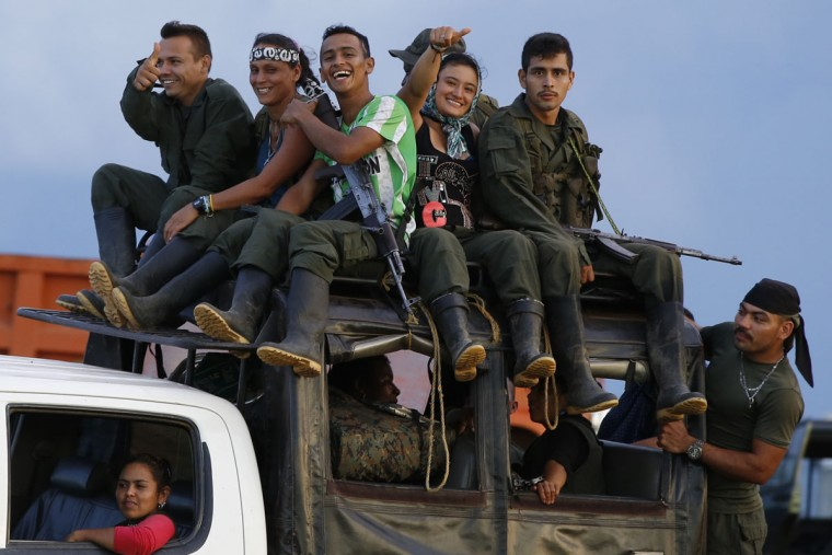 In this Friday, Sept. 16, 2016 photo, rebels of the Revolutionary Armed Forces of Colombia (FARC) arrive in the Yari Plains in southern Colombia. FARC rebels are gathering for a congress to discuss and vote on a peace accord reached with the Colombian government to end five decades of war. Historically secretive, this congress is the first one open to civilians. (AP Photo/Ricardo Mazalan)