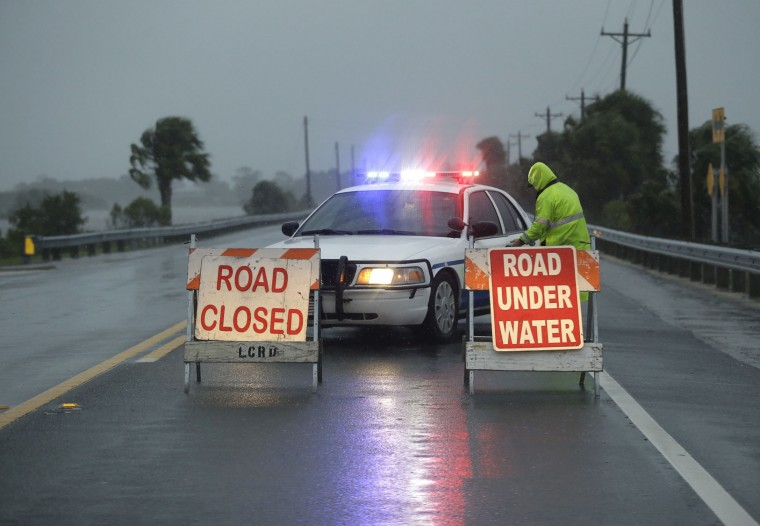 Police block the road entering Cedar Key, Fla., as Hurricane Hermine nears the Florida coast, Thursday, Sept. 1, 2016. Hurricane Hermine gained new strength Thursday evening and roared ever closer to Florida's Gulf Coast, where rough surf began smashing against docks and boathouses and people braced for the first direct hit on the state from a hurricane in over a decade. (AP Photo/John Raoux)