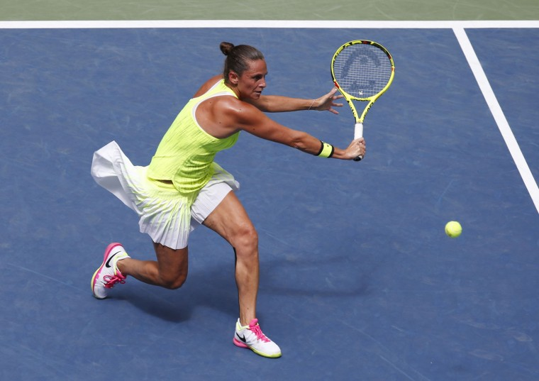 Roberta Vinci, of Italy, returns a shot to Angelique Kerber, of Germany, during the quarterfinals of the U.S. Open tennis tournament, Tuesday, Sept. 6, 2016, in New York. (AP Photo/Kathy Willens)