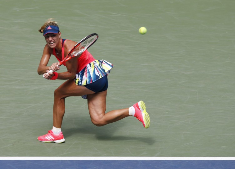 Angelique Kerber, of Germany, returns a shot to Roberta Vinci, of Italy, during the quarterfinals of the U.S. Open tennis tournament, Tuesday, Sept. 6, 2016, in New York. (AP Photo/Kathy Willens)