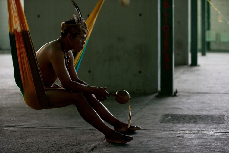A Piaroa Indian man rests after arriving from Amazonas State to attending an opposition protest in Caracas, Venezuela, Wednesday, Aug. 31, 2016. These Piaroa are opponents of President Nicolas Maduro and are part of the movement preparing to flood the streets of Caracas in what is shaping up to be a major test of their strength and the government's ability to tolerate growing dissent. (AP Photo/Fernando Llano)