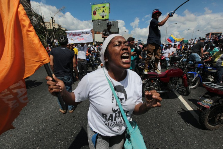 "A demonstrator shouts insults against Venezuela's President Nicolas Maduro during a protest in Caracas, Venezuela, Thursday, Sept. 1, 2016. Venezuela's opposition is vowing to keep up pressure on President Nicolas Maduro after flooding the streets of Caracas with demonstrators Thursday in its biggest show of force in years. Protesters filled dozens of city blocks in what was dubbed the ""taking of Caracas"" to pressure electoral authorities to allow a recall referendum against Maduro this year. (AP Photo/Fernando Llano)"
