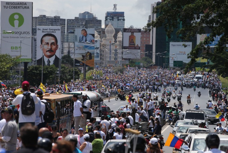 "Demonstrators take part in the ""taking of Caracas"" march in Caracas, Venezuela, Thursday, Sept 1, 2016. Venezuela's opposition is vowing to keep up pressure on President Nicolas Maduro after flooding the streets of Caracas with demonstrators Thursday in its biggest show of force in years. Protesters filled dozens of city blocks in what was dubbed the ""taking of Caracas"" to pressure electoral authorities to allow a recall referendum against Maduro this year. (AP Photo/Fernando Llano)"