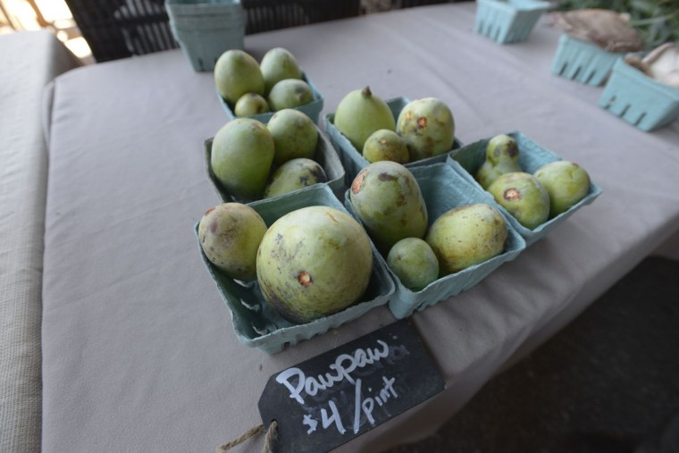 Pawpaws for sale at the Two Boots stand at the Sunday Farmers' Market in Baltimore. (Christina Tkacik/Baltimore Sun)