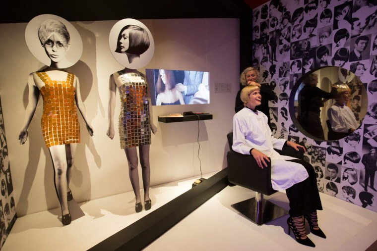 "A model poses getting 1960s hair style from a Sassoon Stylist at a hair salon exhibit during a photo-call for the ""You Say You Want a Revolution? Records and Rebels 1966-70"" exhibition at the V&A museum in central London on September 7, 2016. The exhibition that aims to trace the significance and impact of the late 1960s on life today opens on September 10. (DANIEL LEAL-OLIVAS/AFP/Getty Images)"