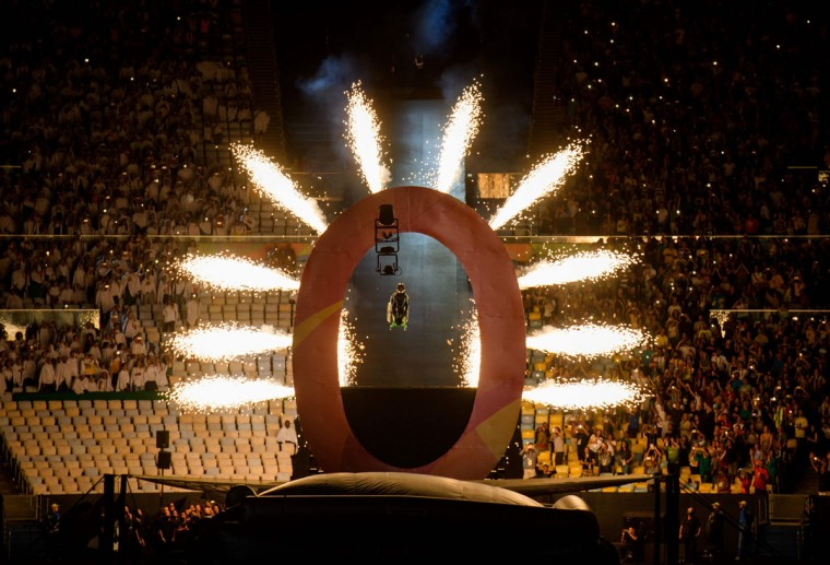 Aaron Wheelz, an extreme wheelchair athlete, goes down a MegaRamp and tears through the panel with the number zero, marking the start of the Opening Ceremony of the Rio 2016 Paralympic Games at the Maracana Stadium in, Rio de Janeiro, Brazil, on September 7, 2016. (Photo by Bob Martin/OIS/IOC via AFP)