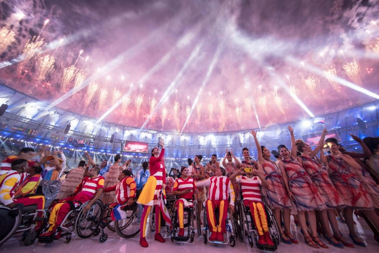 Participants react under fireworks during the opening ceremony of the Rio 2016 Paralympic Games at the Maracana stadium in Rio de Janeiro on September 7, 2016. (YASUYOSHI CHIBA/AFP/Getty Images)