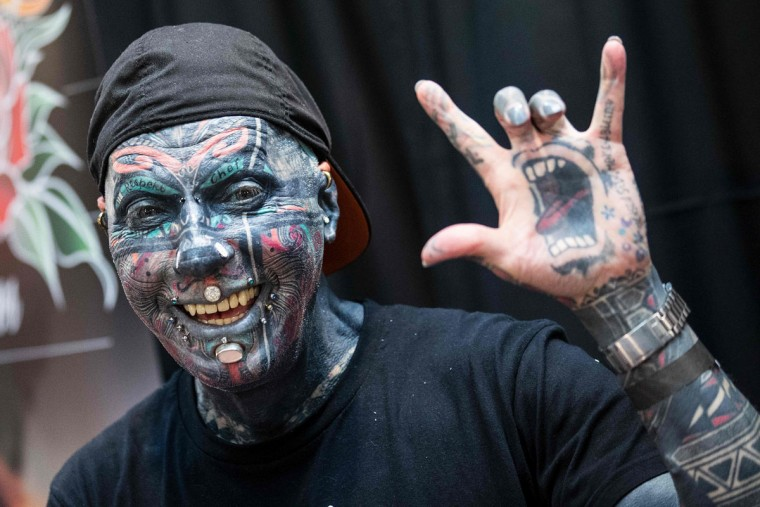 German tattoo model Magneto poses for a picture during the Israel Tattoo Convention in the Israeli coastal city of Tel Aviv, on October 07, 2016 Thousands of people are coming to visit today as over 140 tattoo artists from around the world showcase their work on the first day of the 4th Israel Tattoo Convention. / (AFP Photo/Jack Guez)