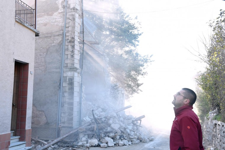 A picture shows the dust caused by the collapse of a building in the village of Borgo Sant'Antonio, central Italy, that was hit by earthquakes, on October 27, 2016. Twin earthquakes rocked central Italy on October 26, 2016 -- the second registering at a magnitude of 6.0 -- in the same region struck in August by a devastating tremor that killed nearly 300 people. The quakes were felt in the capital Rome, sending residents running out of their houses and into the streets. The second was felt as far away as Venice in the far north, and Naples, south of the capital. (Tiziana Fabi/AFP/Getty Images)