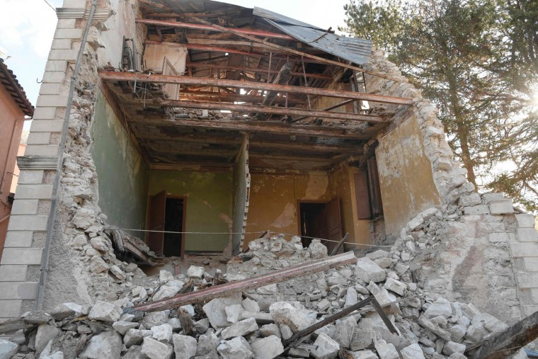 A picture shows a destroyed house in the village of Borgo Sant'Antonio hit by earthquakes, on October 27, 2016 near Visso, central Italy. Twin earthquakes rocked central Italy on October 26, 2016 -- the second registering at a magnitude of 6.0 -- in the same region struck in August by a devastating tremor that killed nearly 300 people. The quakes were felt in the capital Rome, sending residents running out of their houses and into the streets. The second was felt as far away as Venice in the far north, and Naples, south of the capital. (Tiziana Fabi/AFP/Getty Images)