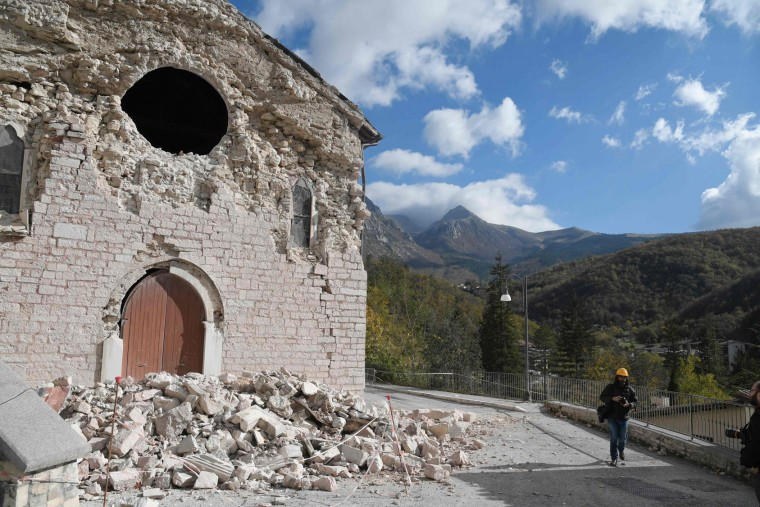 A picture shows a damaged church in Ussita, central Italy, a day after twin earthquakes rocked the area, on October 27, 2016. Two months after a quake left nearly 300 dead in the country's tremor-prone central spine, two powerful shocks ripped through the mountainous, sparsely-populated region on Wednesday evening. Despite numerous building collapses, no deaths had been reported by midday, more than 17 hours after the first of the 5.5 and 6.1 magnitude tremors. (Tiziana Fabi/AFP/Getty Images)