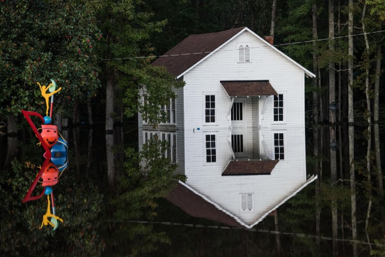 LUMBERTON, NC - OCTOBER 10: A building is inundated with floodwaters on October 10, 2016 in Lumberton, North Carolina. The death toll from Hurricane Matthew in the U.S. has climbed to over 20. (Photo by Sean Rayford/Getty Images)