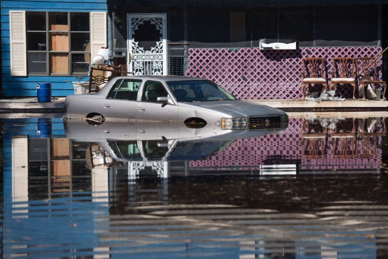 FAIR BLUFF, NC - OCTOBER 11: A residence is inundated with floodwaters from the Lumber River on October 11, 2016 in Fair Bluff, North Carolina. Thousands of homes have been damaged in North Carolina as a result of Hurricane Matthew and many are still under threat of flooding. (Photo by Sean Rayford/Getty Images)