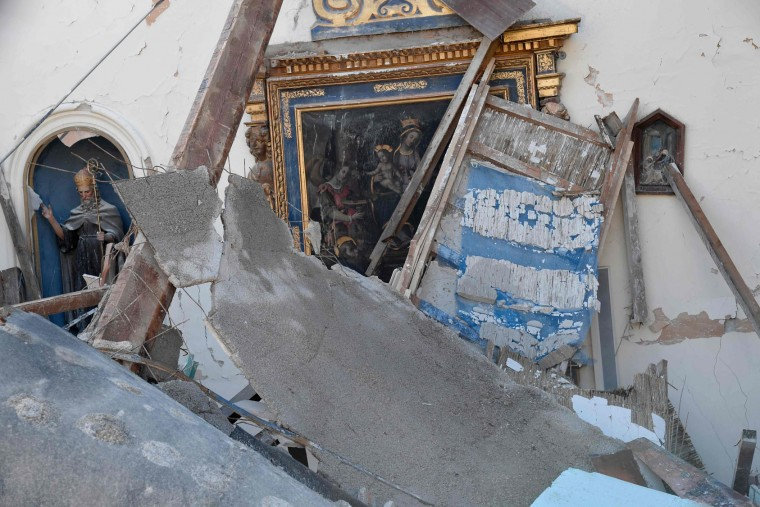 A picture shows the church of Borgo Sant'Antonio damaged by earthquakes, on October 27, 2016 near Visso, central Italy. Twin earthquakes rocked central Italy on October 26, 2016 -- the second registering at a magnitude of 6.0 -- in the same region struck in August by a devastating tremor that killed nearly 300 people. The quakes were felt in the capital Rome, sending residents running out of their houses and into the streets. The second was felt as far away as Venice in the far north, and Naples, south of the capital. (Tiziana Fabi/AFP/Getty Images)