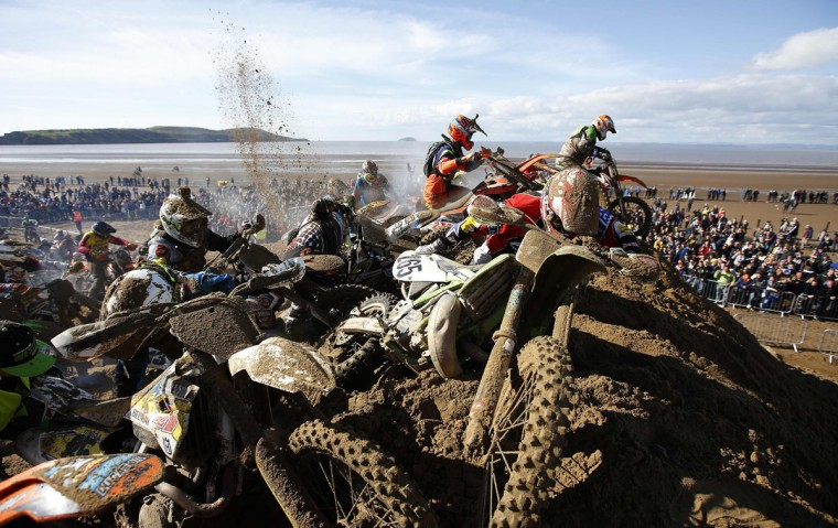 Riders attempt to reach the summit of a dune as they compete in the Adult Solo race at the HydroGarden Weston Beach Race in Weston-super-Mare, south west England, on October 9, 2016. Beach racing is an offshoot of enduro and motocross racing. Riders on solo motorcycles and quad bikes compete on a course marked out on a beach, with man-made jumps and sand dunes being constructed to make the course tougher. (ADRIAN DENNIS/AFP/Getty Images)
