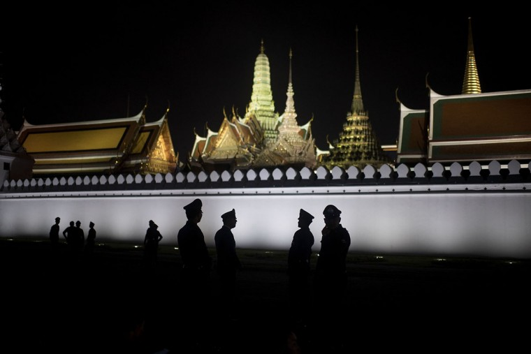 Thai police stand outside the Grand Palace as the Royal bathing for King Bhumibol Adulyadej is occurring inside the Dusit Maha Prasat Throne on October 14, 2016 in Bangkok, Thailand. Thailand's King Bhumibol Adulyadej, the world's longest-reigning monarch, died at the age of 88 in Bangkok's Siriraj Hospital on Thursday after his 70-year reign. Prime Minister Prayut Chan-ocha made a statement Thailand would hold a one-year mourning period as the Crown Prince Maha Vajiralongkorn confirmed that he would perform his duty as heir to the throne. (Photo by Borja Sanchez Trillo/Getty Images)