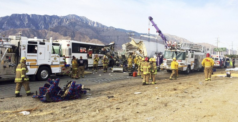 Mangled bus seats are seen at left as emergency personnel work the scene where a tour bus crashed into the rear of a semi-truck on westbound Interstate 10 just north of the desert resort town of Palm Springs, in Desert Hot Springs, Calif., Sunday, Oct. 23, 2016. Multiple deaths and injuries were reported. (Colin Atagi/The Desert Sun via AP)