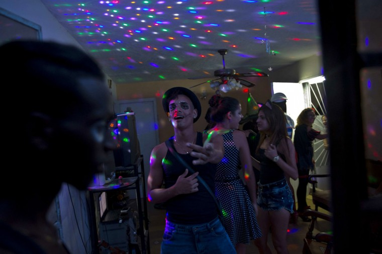 Youth in costume dance at a Halloween party at a residence in Havana, Cuba, Friday, Oct. 28, 2016. The rising popularity of Halloween is one of many manifestations of the decades-long intermingling of Cuban and U.S. culture despite the half-century of hostility between the two countries' governments. (AP Photo/Ramon Espinosa)