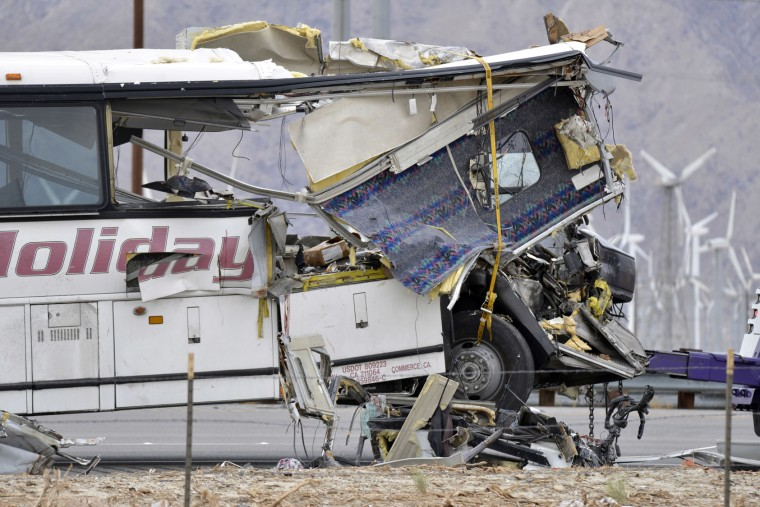 The damaged front of a tour bus is seen that crashed into the back of a semi-truck on Interstate 10 just north of the desert resort town of Palm Springs, in Desert Hot Springs, Calif., Sunday, Oct. 23, 2016. Several deaths and injuries were reported. (AP Photo/Rodrigo Pena)