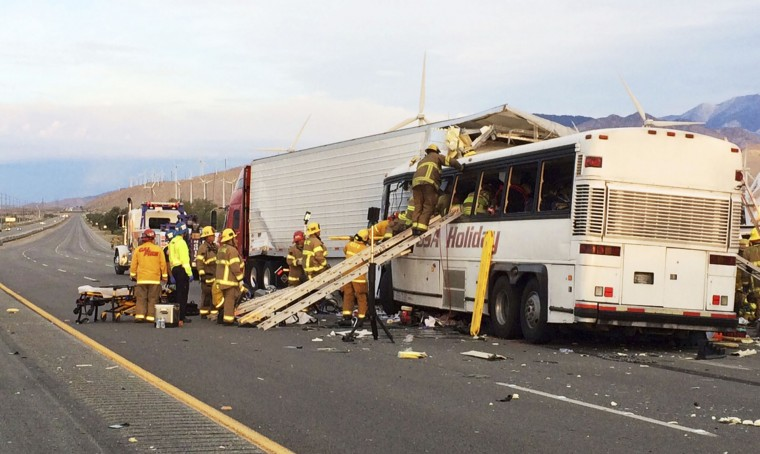 Emergency personnel work the scene where a tour bus crashed into the rear of a semi-truck on westbound Interstate 10, just north of the desert resort town of Palm Springs, in Desert Hot Springs, Calif., Sunday, Oct. 23, 2016. Multiple deaths and injuries were reported. (Colin Atagi/The Desert Sun via AP)