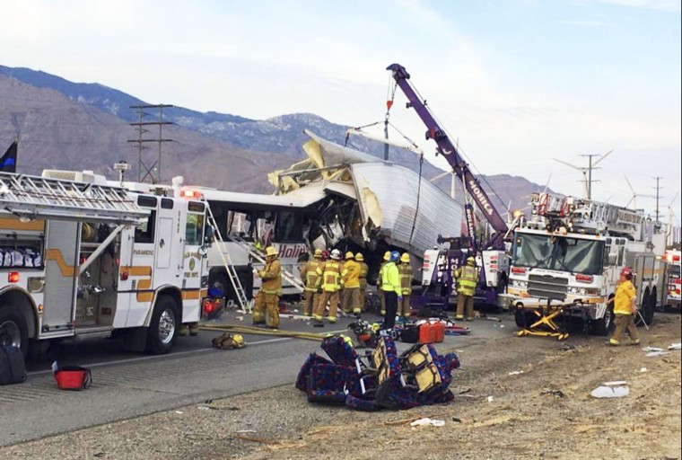 This photo provided by KESQ NewsChannel 3/CBS Local 2 shows the scene of crash between a tour bus and a semi-truck on Interstate 10 near Desert Hot Springs, near Palm Springs, in California's Mojave Desert Sunday, Oct. 23, 2016. Multiple deaths and injuries were reported. (Chris Tarpening/KESQ NewsChannel 3/CBS Local 2 via AP)