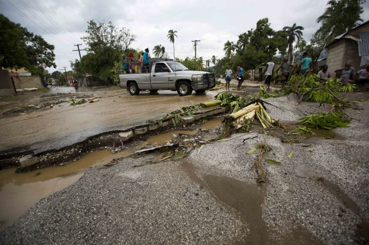 A truck negotiates a road damaged by Hurricane Matthew, in Petit Goave, Haiti, Wednesday, Oct. 5, 2016. Rescue workers in Haiti struggled to reach cutoff towns and learn the full extent of the death and destruction caused by Hurricane Matthew as the storm began battering the Bahamas on Wednesday and triggered large-scale evacuations along the U.S. East Coast. (AP Photo/Dieu Nalio Chery)