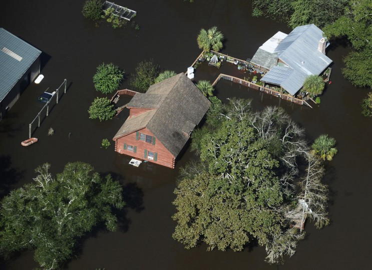 A home sits in floodwaters in Nichols, S.C., Monday, Oct. 10, 2016. Nearly 1 million homes and businesses still did not have power Monday morning in the Carolinas after Hurricane Matthew. (AP Photo/Rainier Ehrhardt)
