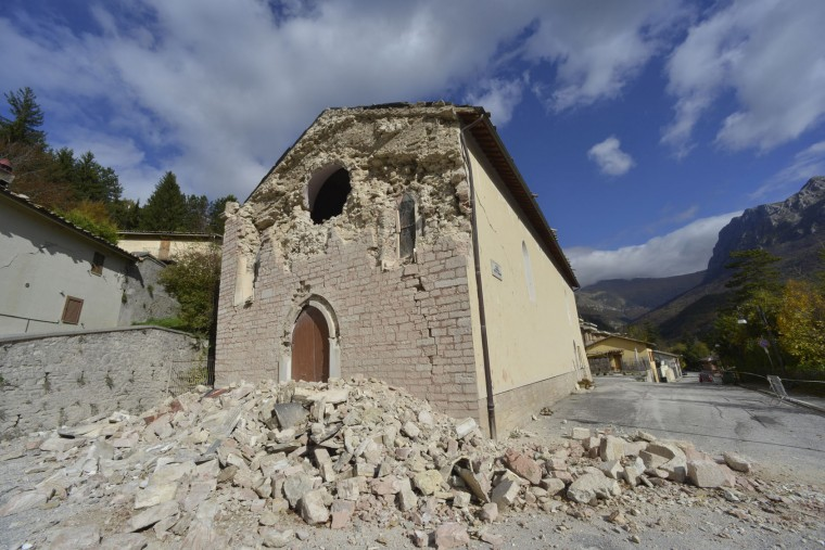 A view of the facade of the Church of Santa Maria Assunta, dating back to 1300, in the small town of Ussita in central Italy, Thursday, Oct 27, 2016, damaged after a 5.9 earthquake destroyed part of the town. A pair of strong aftershocks shook central Italy late Wednesday, crumbling churches and buildings, knocking out power and sending panicked residents into the rain-drenched streets just two months after a powerful earthquake killed nearly 300 people. (AP Photo/Sandro Perozzi)