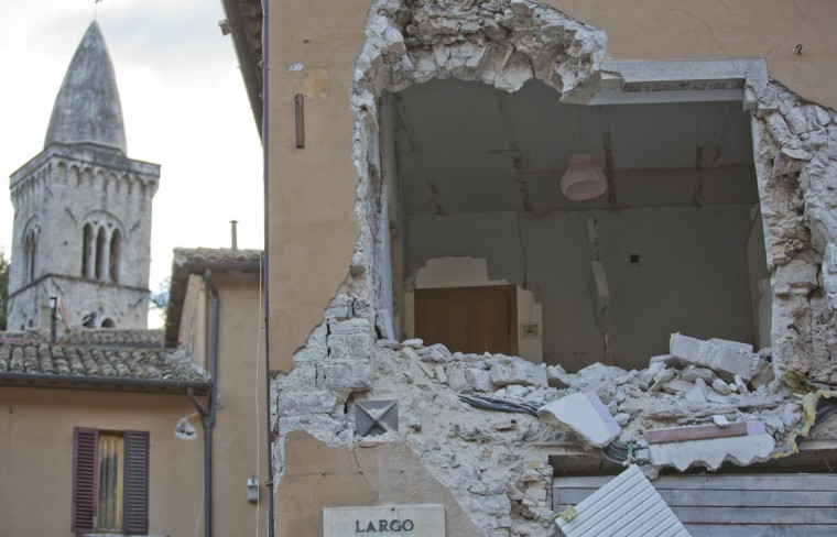 A damaged house in the small town of Visso in central Italy, Thursday, Oct 27, 2016, after a 5.9 earthquake destroyed part of the town. A pair of strong aftershocks shook central Italy late Wednesday, crumbling churches and buildings, knocking out power and sending panicked residents into the rain-drenched streets just two months after a powerful earthquake killed nearly 300 people. (AP Photo/Alessandra Tarantino)