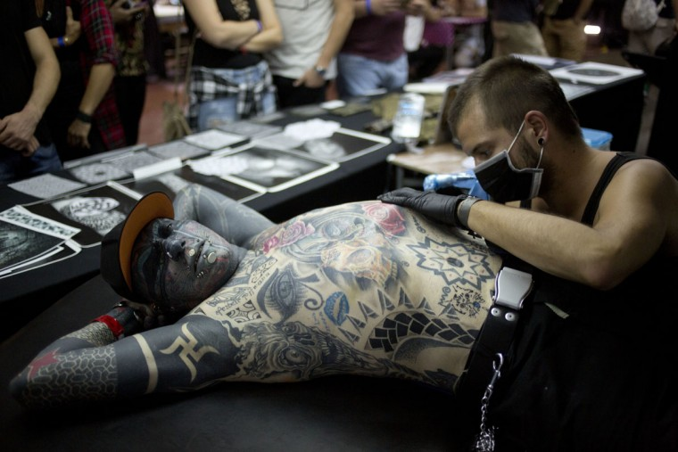 Magneto of Berlin Germany has a mother tattoo on is body during the Israel Tattoo Convention in Tel Aviv, Israel, Friday, Oct. 7, 2016. Around 140 tattoo artist from Israel and other countries participated in a 2 day fair in Tel Aviv. (AP Photo/Ariel Schalit)
