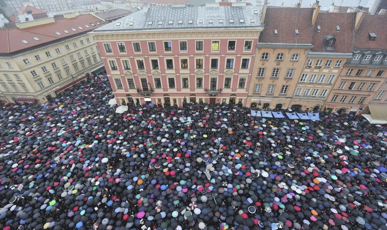 "A sea of thousands of umbrellas of women and men participating in a nationwide ""Black Monday"" strike to protest a legislative proposal for a total ban on abortion, in downtown Castle Square is pictured in Warsaw, Poland, Monday, Oct. 3, 2016. Massive protests were held in the rain in the streets of Warsaw, Gdansk, Wroclaw and elsewhere across the largely Catholic nation led by a conservative government. (AP Photo/Czarek Sokolowski)"