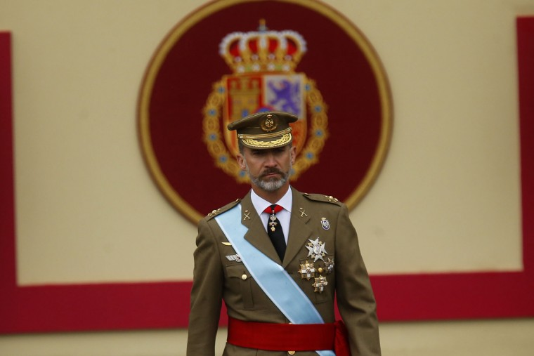 "Spain's King Felipe walks at a military parade during a national holiday known as ""Dia de la Hispanidad"" or Hispanic Day, in Madrid, Spain, Wednesday, Oct. 12, 2016. Almost a year into Spain's political deadlock, the country is celebrating its National Day with a military parade of over 3,000 soldiers marching through Madrid and aircraft drawing trails of red and yellow smoke in the sky to represent the flag. (AP Photo/Francisco Seco)"