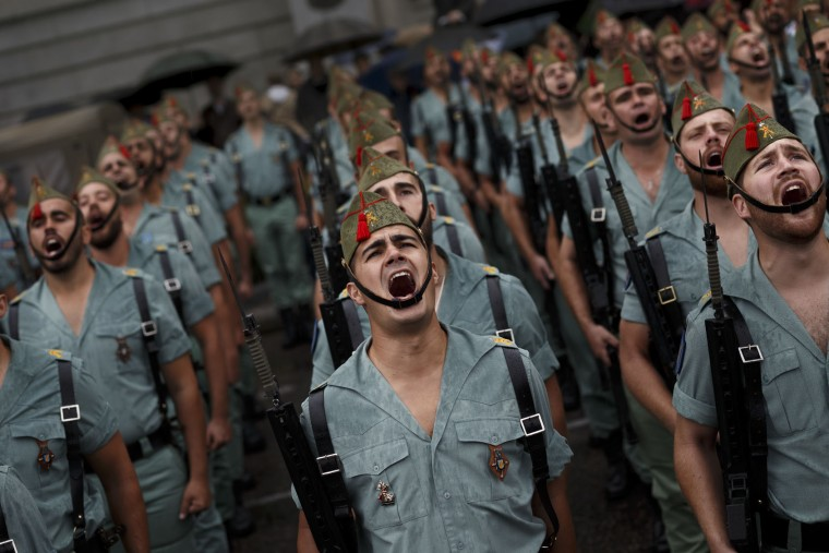 Members of La Legion, an elite unit of the Spanish Army, sings before a military parade as they celebrate a holiday known as 'Dia de la Hispanidad' or Hispanic Day in Madrid, Wednesday, Oct. 12, 2016. Almost a year into Spain's political deadlock, the country is celebrating its National Day with a military parade of over 3,000 soldiers marching through Madrid and aircraft drawing trails of red and yellow smoke in the sky to represent the flag. (AP Photo/Daniel Ochoa de Olza)