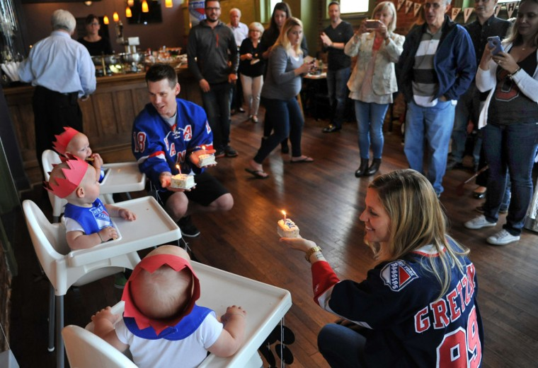 Thomas and Kristen Hewitt of Hampden celebrate the first birthday of their triplets, from front to back, Trip, Finn and Ollie, as family and friends take pictures at Cafe Hon. The identical triplets turned one on Oct. 6. (Amy Davis/ Baltimore Sun)