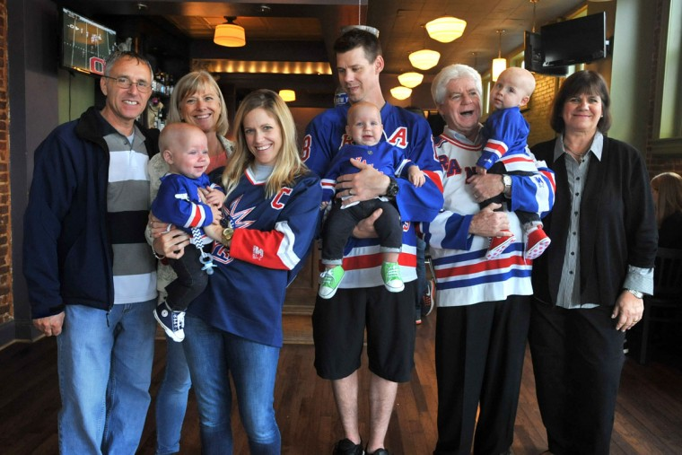 A family portrait with the grandparents includes, from left, Jim and Kathy Stantz, Kristen Hewitt holding Ollie, Thomas Hewitt Jr. holding Finn, Thomas Hewitt Sr. holding Trip, and Terry Hewitt. The family celebrated the first birthday of their triplets at Cafe Hon. (Amy Davis/ Baltimore Sun)