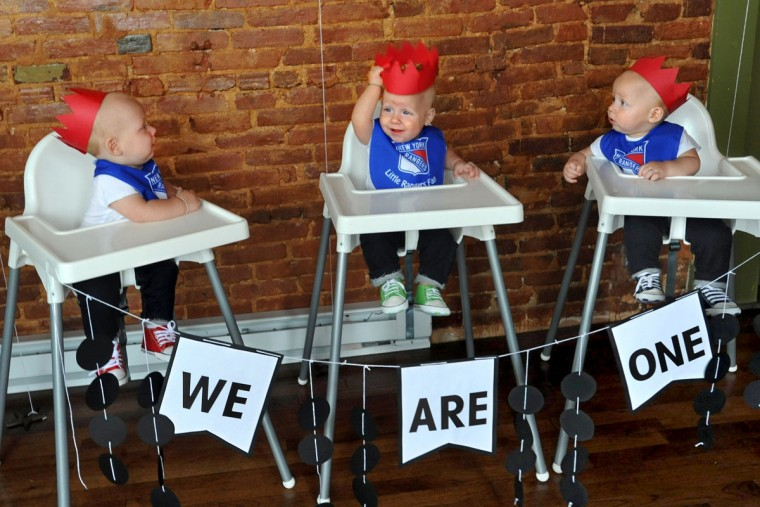 Identical triplets Trip, Finn and Ollie Hewitt wear red paper crowns as they await their first taste of birthday cake at the party to celebrate becoming one-year olds. Thomas and Kristen Hewitt of Hampden celebrated the first birthday for their triplets with family and friends at Cafe Hon. The identical triplets turned one on Oct. 6. (Amy Davis/ Baltimore Sun)