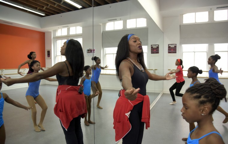Sharayna A. Christmas Rose, founder of Rayn Fall Dance Studio teaches students adagio in a combined levels ballet class. (Algerina Perna/Baltimore Sun)