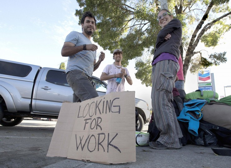"In this Wednesday, Oct. 12, 2016 photo, Rachel Perez, 22, right, who traveled from Spain with three companions seeks work as a marijuana ""trimmer"" in Garberville, Calif. Perez and her friends are among those that flock to the area seeking work in the marijuana grows. If approved by voters in November Proposition 64, would legalize the recreational use of marijuana. (AP Photo/Rich Pedroncelli)"