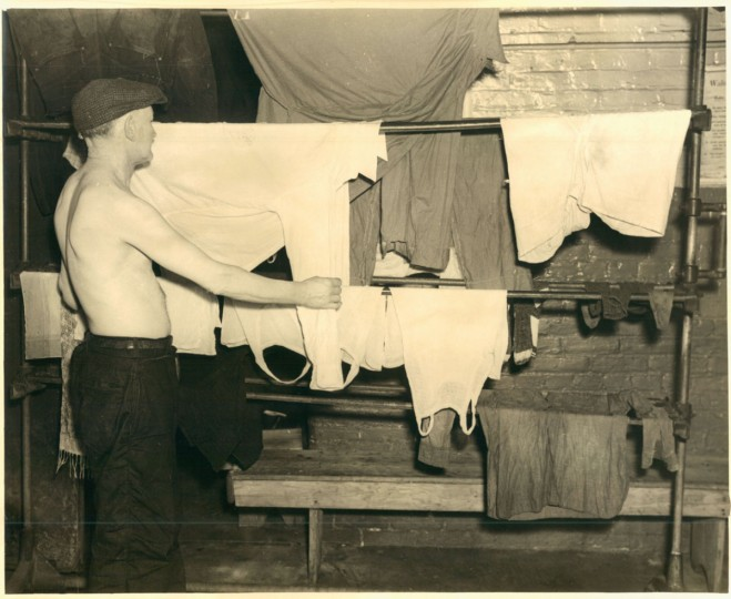 "Public baths were also a place to do laundry, as this photo from 1939 illustrates. ""In those days you could even get a bar of soap for an extra nickel and wash your shirt, socks and underclothes, then sit around with other wanderers and gossip while your garments were hung up for drying,"" said an article in The Sun in 1959. (Baltimore Sun)"