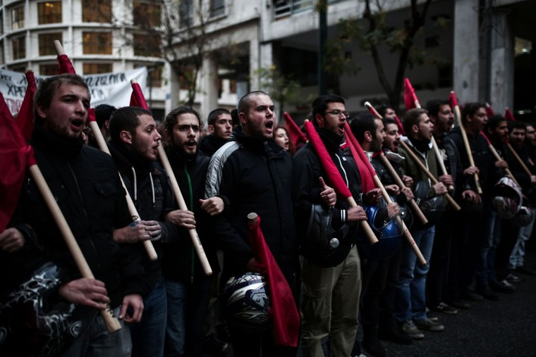 Protesters demonstrate against the visit of the US president around the Polytechnic school in Athens on November 15, 2016. US President Barack Obama is in Greece on a two-day official visit. (Angelos Tzortzinis/AFP/Getty Images)