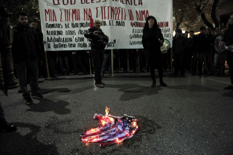 Protestors burn a US flag during a demonstration against the visit of the US president in Thessaloniki on November 15, 2016. US President Barack Obama flew into Athens on his final foreign trip to Europe, seeking to calm the nerves of allies concerned by Donald Trump's shock presidential election victory. (Sakis Mitrolidis/AFP/Getty Images)