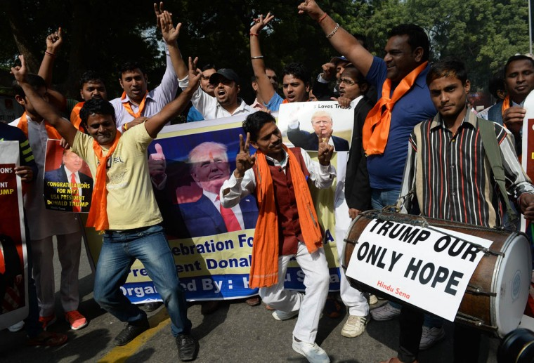 Right-wing activists of India's Hindu Sena celebrate the victorious outcome for US Republican presidential candidate Donald Trump in the US presidential elections in New Delhi on November 9, 2016. A far-right Hindu group which has been one of Donald Trump's most avid overseas cheerleaders began celebrating in New Delhi Wednesday as the Republican pulled off a shock US presidential election victory. / AFP PHOTO / PRAKASH SINGH