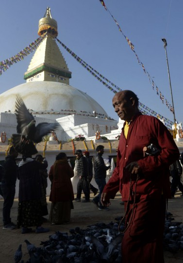 A Buddhist monk and devotees circle Boudhanath Stupa as it is reopened following renovation for earthquake damage on the outskirts of Kathmandu on November 22, 2016. Boudhanath Stupa was among hundreds of historic monuments damaged during the 7.8-magnitude quake that hit Nepal in April 2015 killing nearly 9,000 people. (Prakash Mathema/AFP/Getty Images)