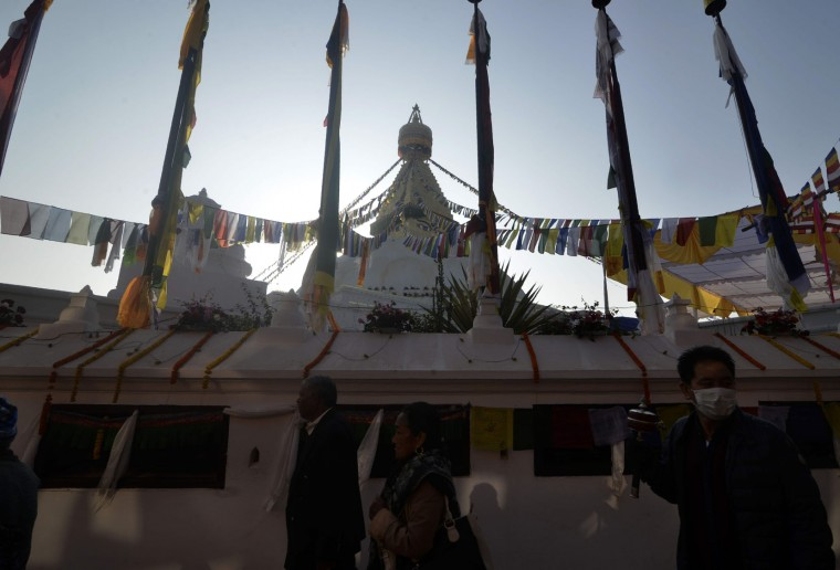Buddhist devotees circle Boudhanath Stupa as it is reopened following renovation for earthquake damage on the outskirts of Kathmandu on November 22, 2016. Boudhanath Stupa was among hundreds of historic monuments damaged during the 7.8-magnitude quake that hit Nepal in April 2015 killing nearly 9,000 people. (Prakash Mathema/AFP/Getty Images)