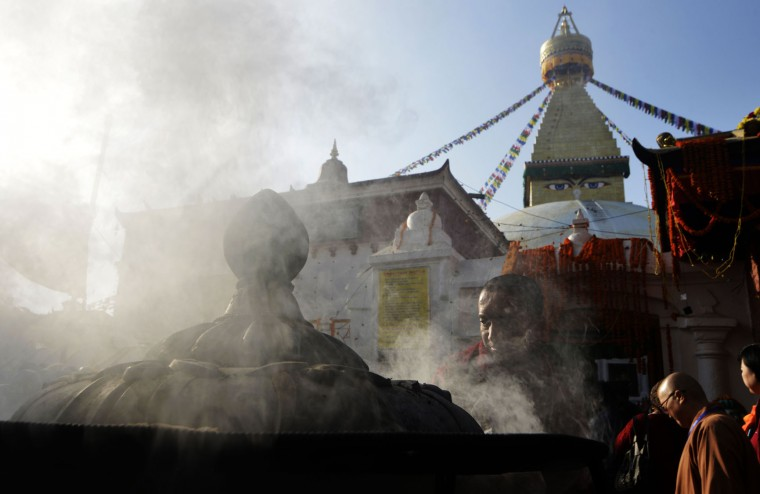 A Buddhist devotee lights incense at Boudhanath Stupa as it is reopened following renovation for earthquake damage on the outskirts of Kathmandu on November 22, 2016. Boudhanath Stupa was among hundreds of historic monuments damaged during the 7.8-magnitude quake that hit Nepal in April 2015 killing nearly 9,000 people. (Prakash Mathema/AFP/Getty Images)