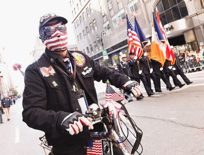 A paradegoer takes part in the annual Veterans Day Parade on November 11, 2016 in New York City. Known as 'America's Parade' it features over 20,000 participants, including veterans of numerous eras, military units, businesses and high school bands and civic and youth groups. (Photo by Michael Loccisano/Getty Images)