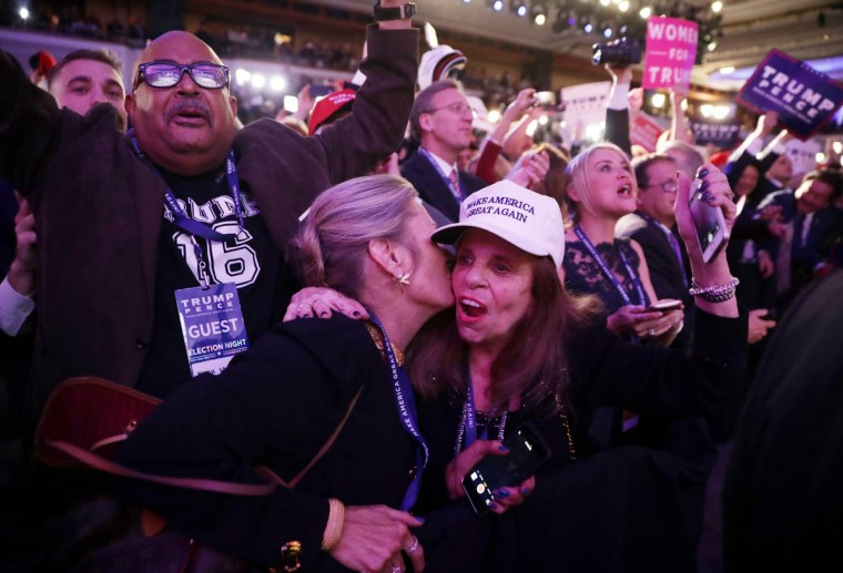 People celebrate during the call for Republican president-elect Donald Trump at his election night event at the New York Hilton Midtown on November 9, 2016 in New York City. at the New York Hilton Midtown in the early morning hours of November 9, 2016 in New York City. Donald Trump defeated Democratic presidential nominee Hillary Clinton to become the 45th president of the United States. (Photo by Chip Somodevilla/Getty Images)